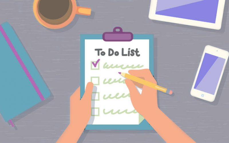 Person checking off items on to do list